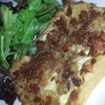 Alsace style caramelized onion tart, crisp smoked bacon bits, herb boursin,  goat and cottage cheeses